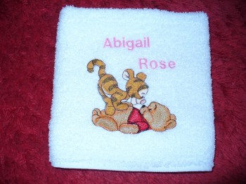 Baby Pooh and Tigger playing embroidered on towel