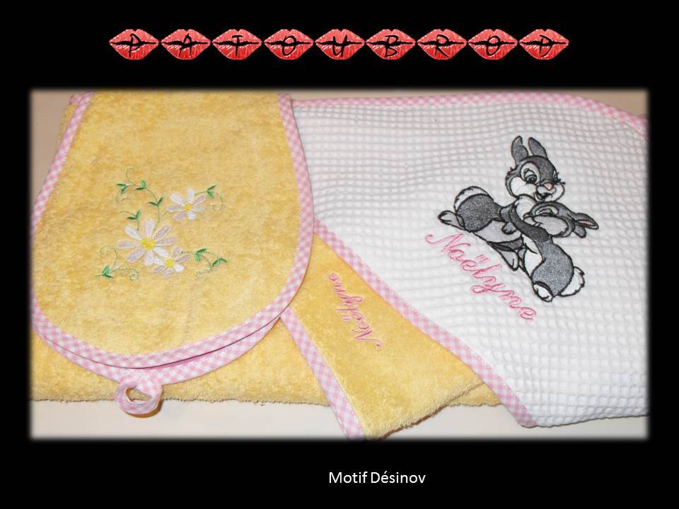 Yellow baby bath towel with bunnies embroidered