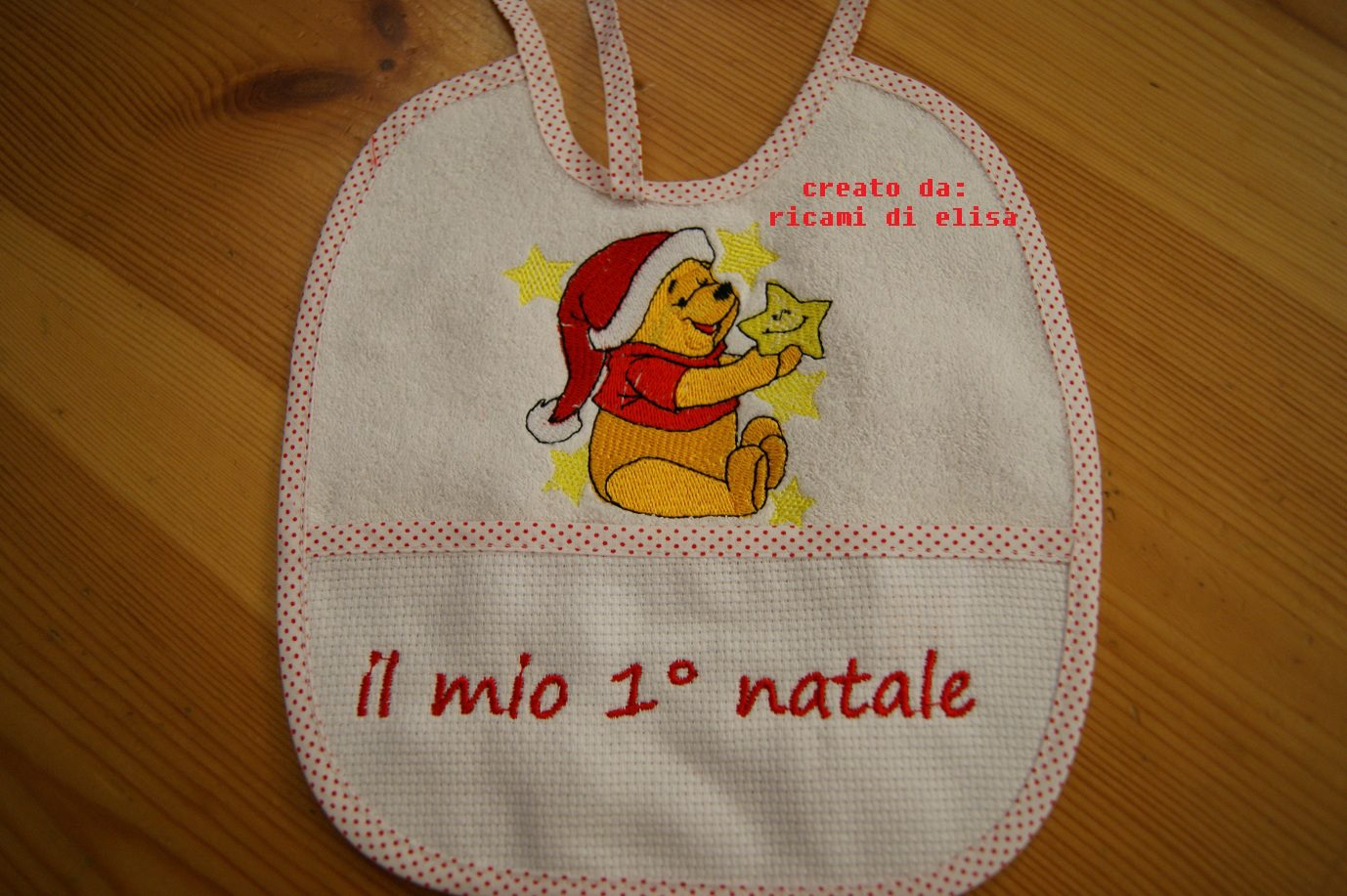 Bib embroidered with Christmas Pooh design