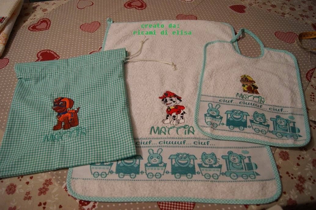 Towel and bib embroidered with Paw Patrol designs