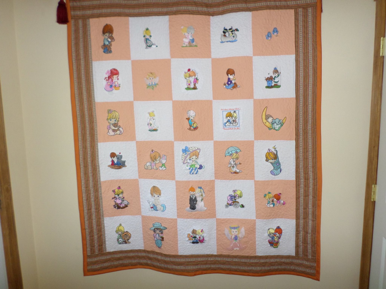 Precious Moments designs on embroidered girlish quilt
