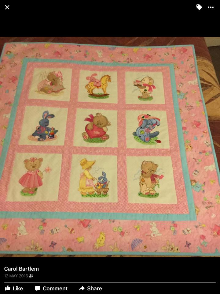 Pink baby quilt with Old toys embroidery designs