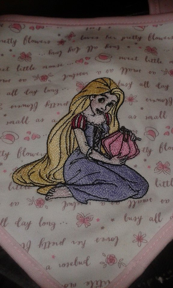 Embroidered baby bib with Rapunzel