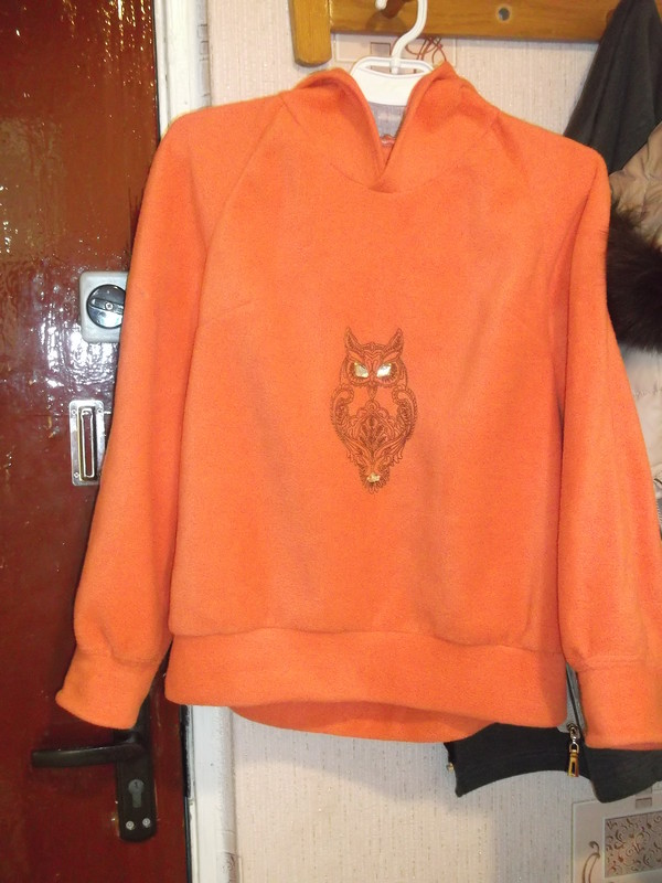 Orange hoodie embroidered with owl design