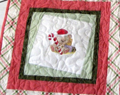 Embroidered quilt with teddy bear with candy cane design