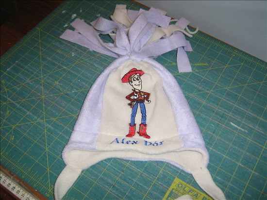 Woody design on hat embroidered