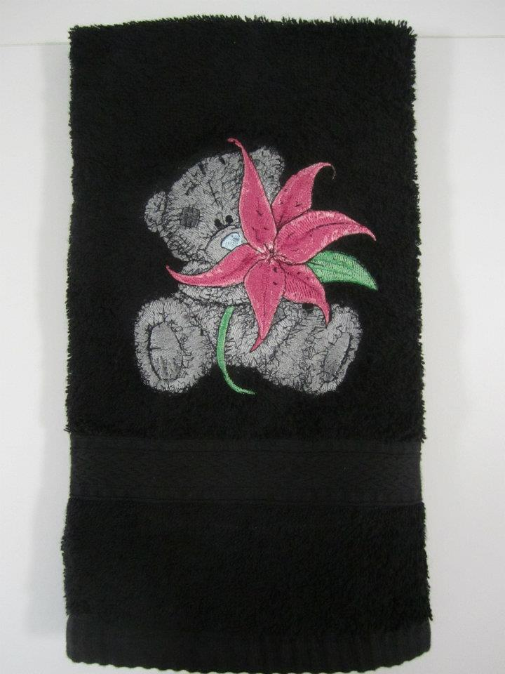 Black bath towel with tatty teddy bear embroidered on it