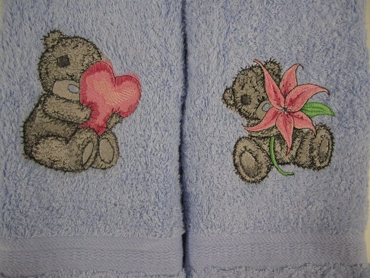 Teddy bear designs on blue embroidered towels