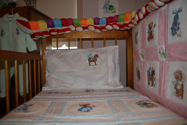 Pillowcase end baby quilt embroidered with old toys designs