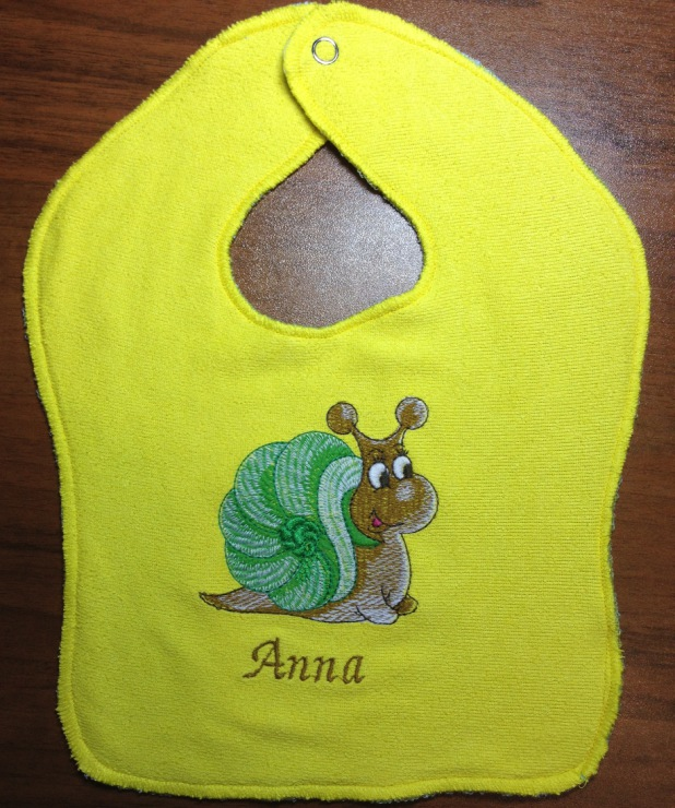 Snail embroidered baby bib