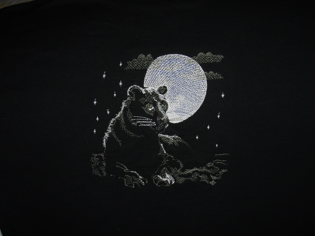 Embroidered panther and moon