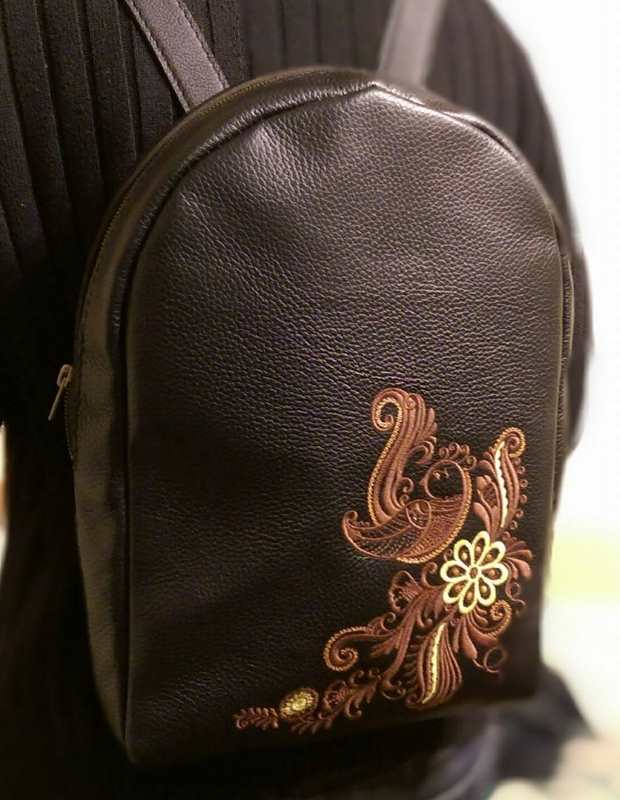 Embroidered backpack with firebird design