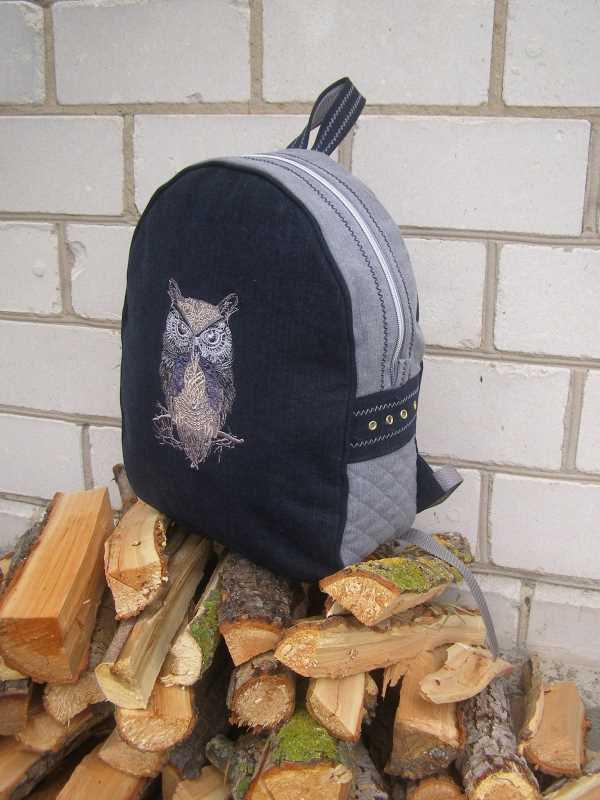 Backpack with tribal bird embroidery