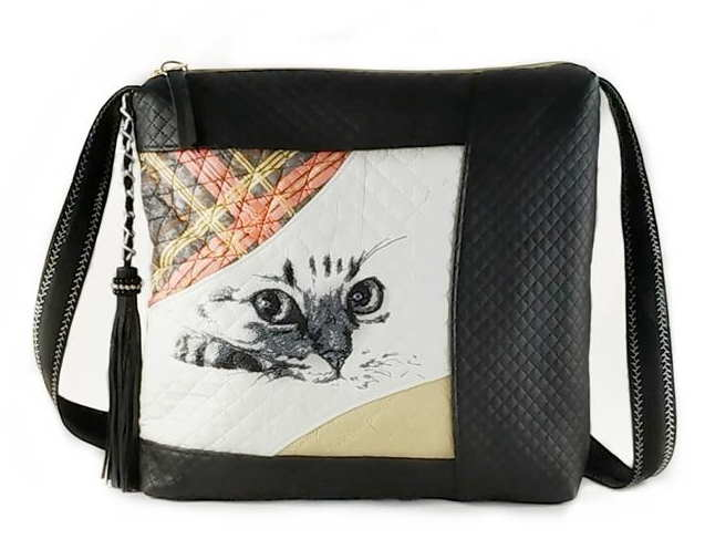 Embroidered handbag with cat muzzle design