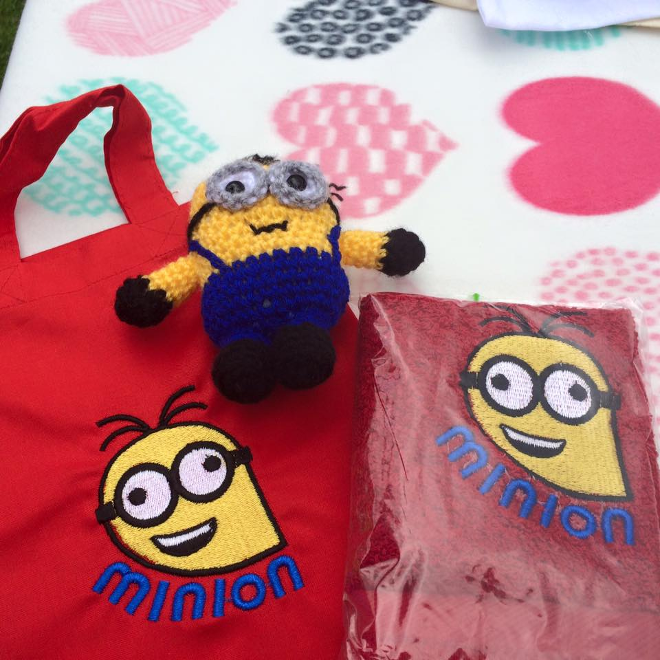 Crazy Minion embroidered on red bag and red towel