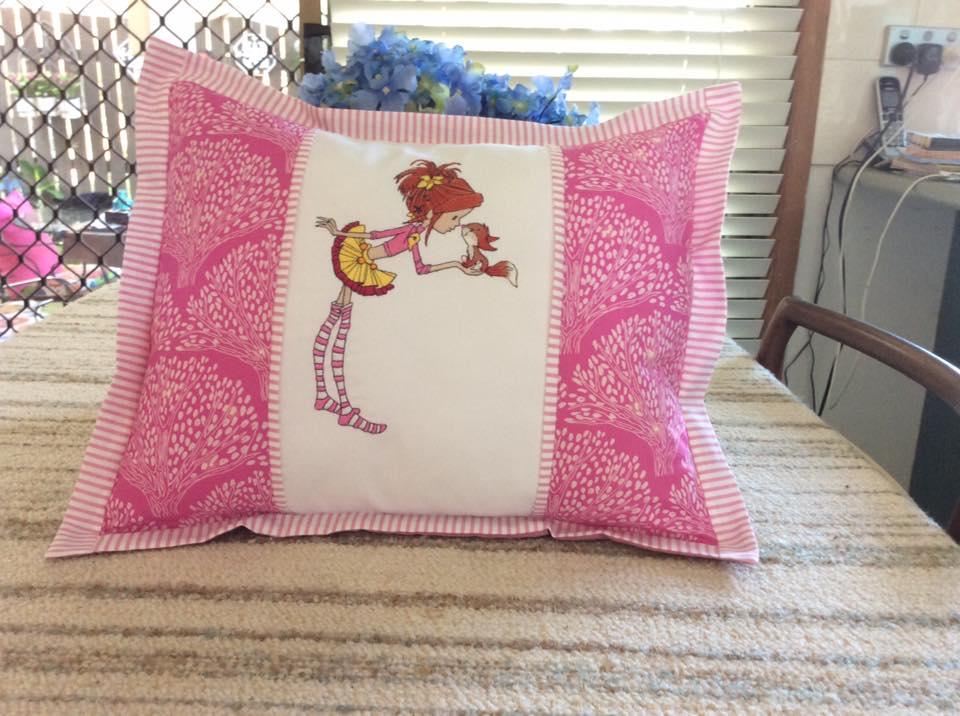 Cushion with girl and squirrel embroidery design