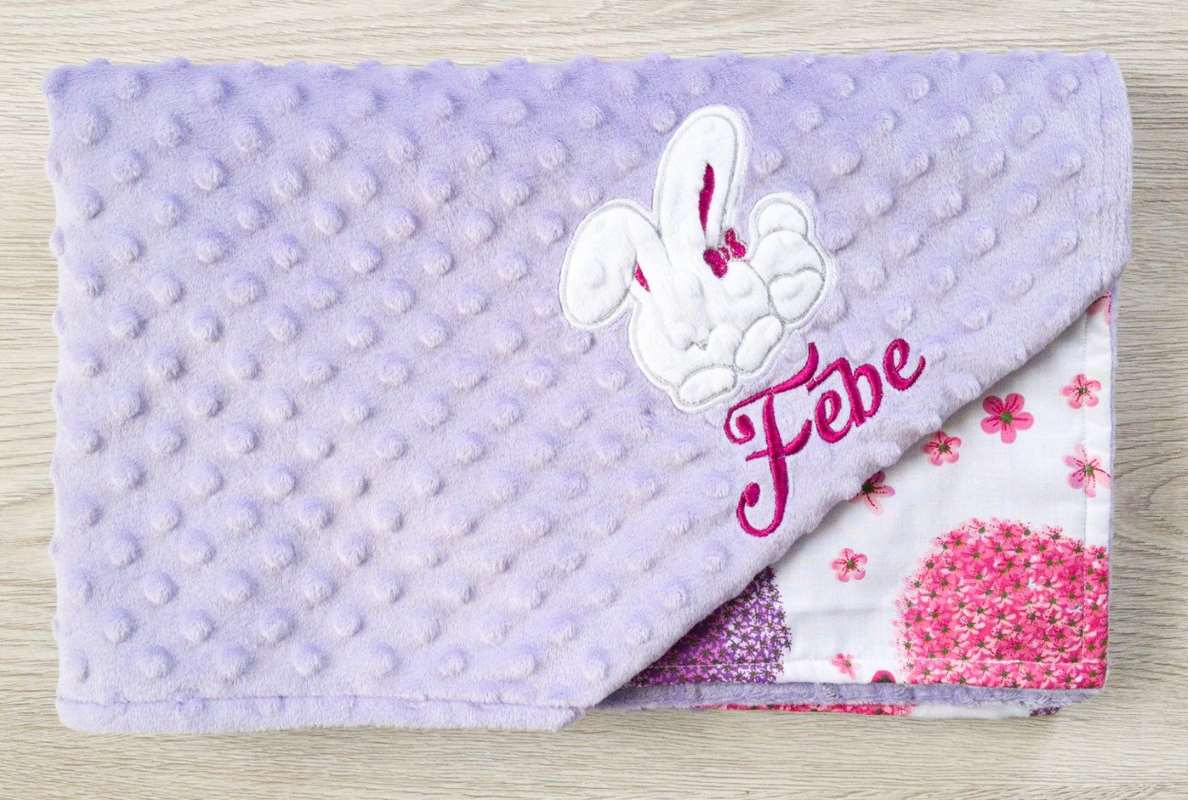 Embroidered towel with bunny applique design