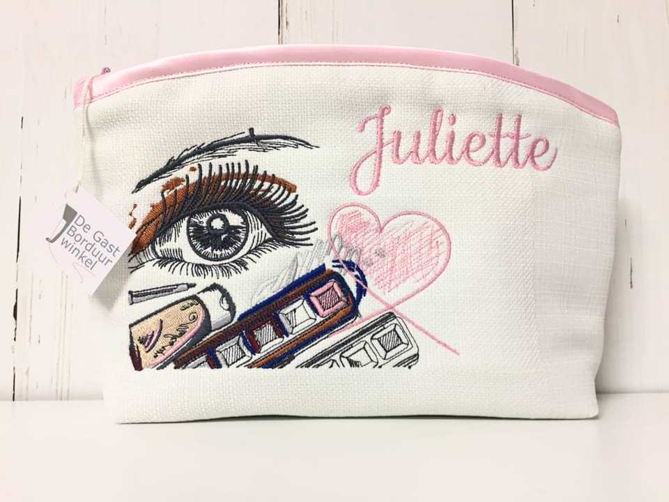 Cosmetic bag with make up embroidery design