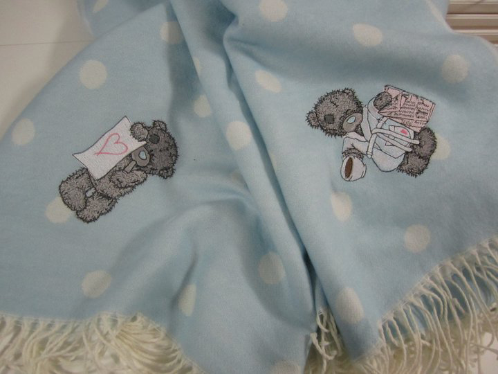 Teddy bear designs on embroidered blue polka dot table cloth