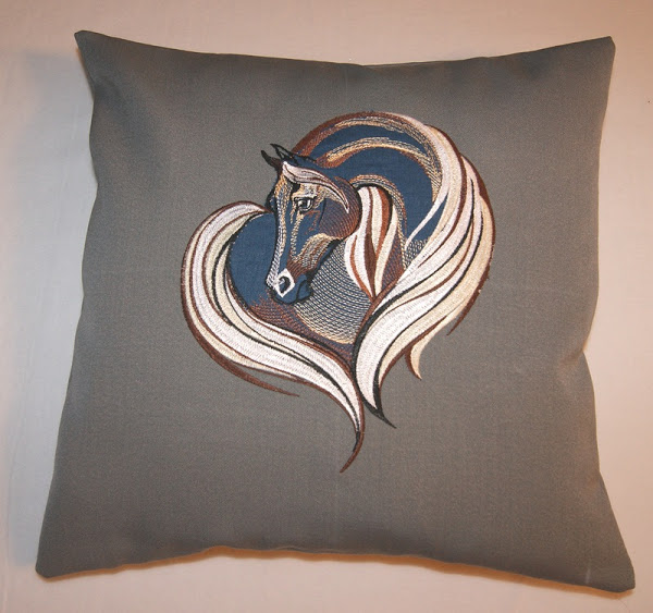Brown pillowcase embroidered with horse design