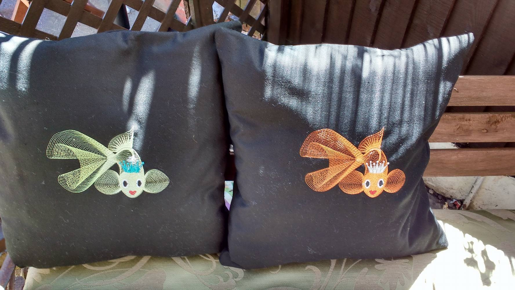 Gold fish embroidered on black pillowcases