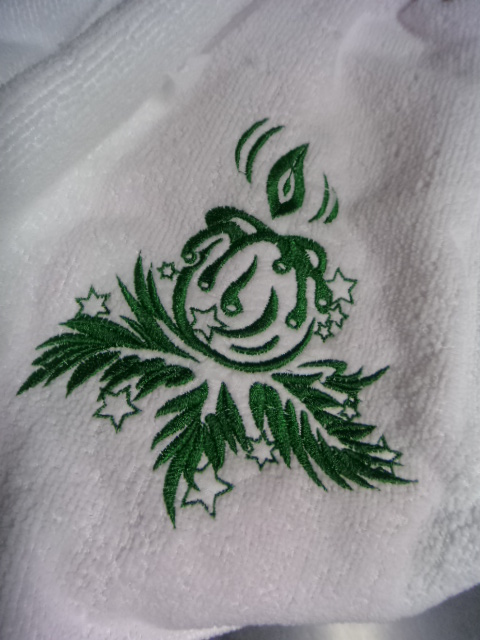 White towel with embroidered Christmas Candle