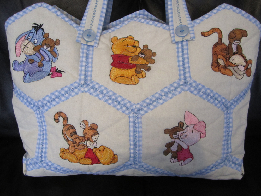 Embroidered nappy bag with baby Pooh designs