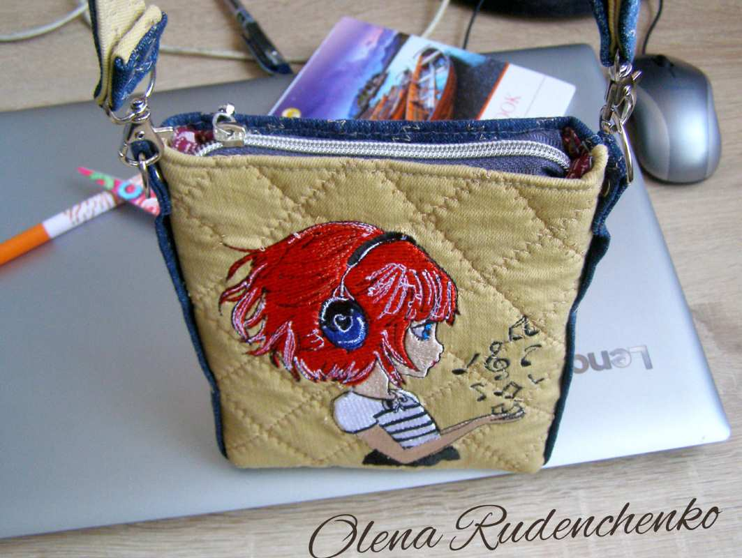 Embroidered bag with music girl design
