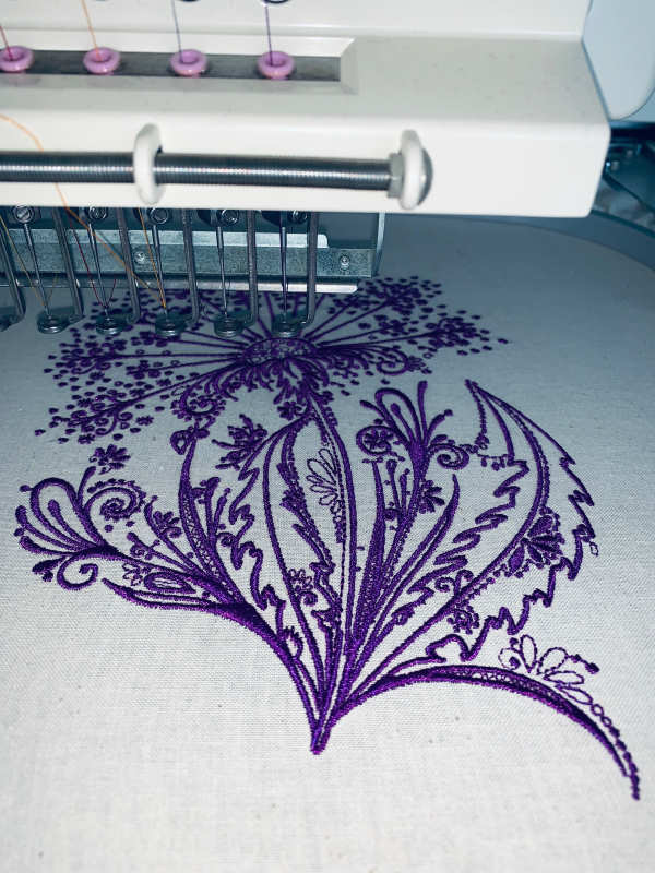 Embroidery process with dandelion design