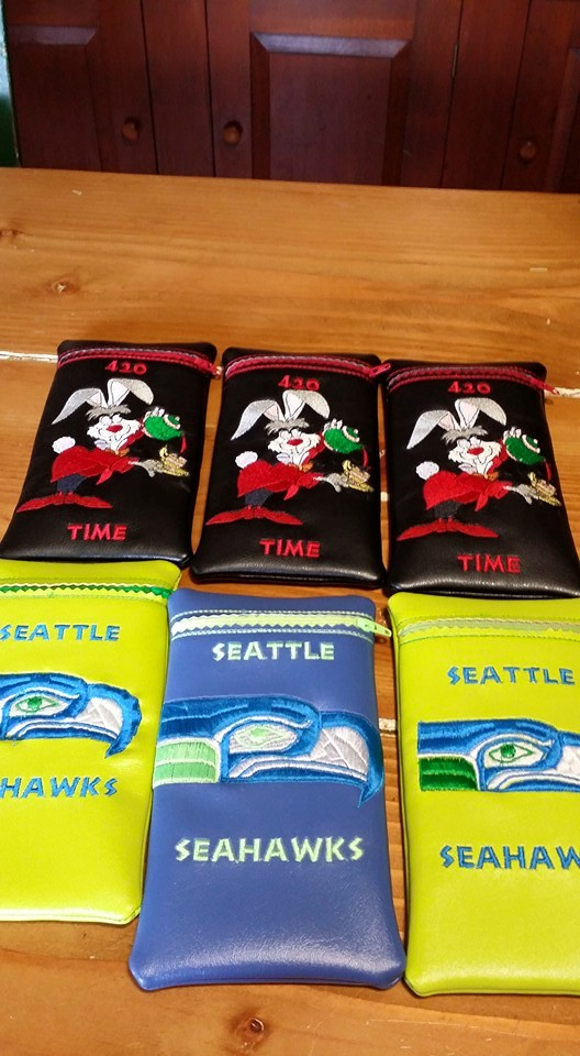 Rabbit and Seahawks logo embroidered on bags