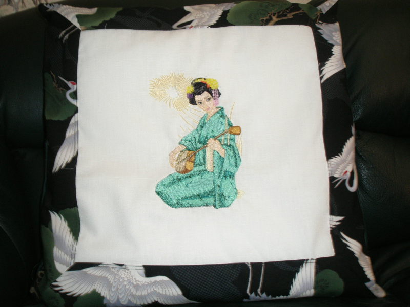 Geisha with musical instrument design on pillowcase embroidered