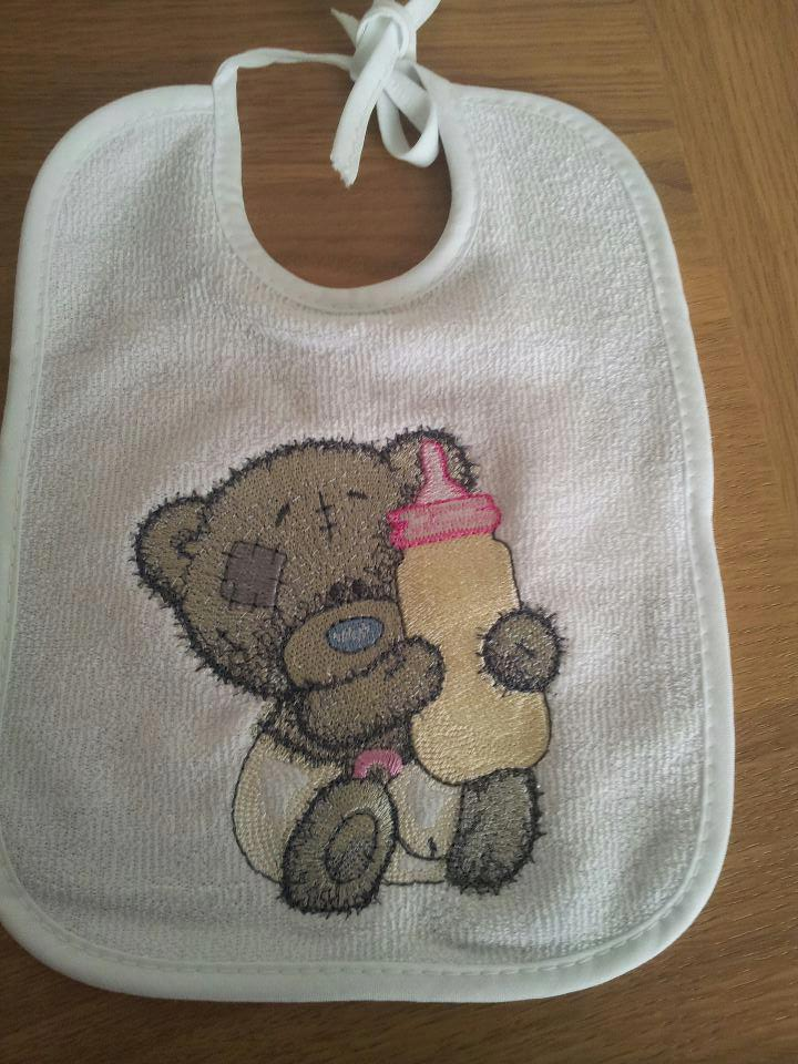 Baby bib with embroidered tiny tatty teddy on it