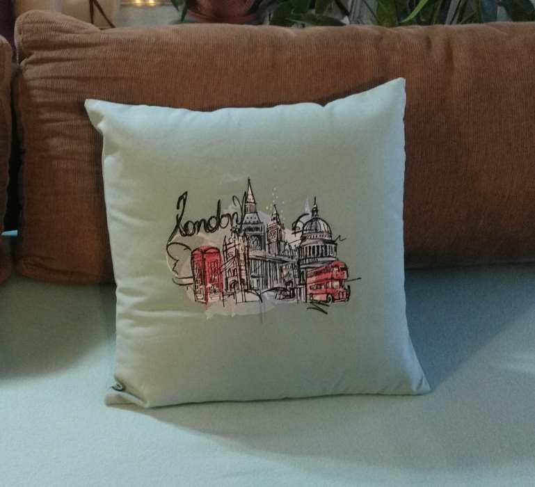 Embroidered cushion with London sketch design