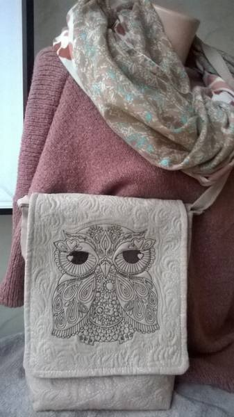 Embroidered bag with owl design