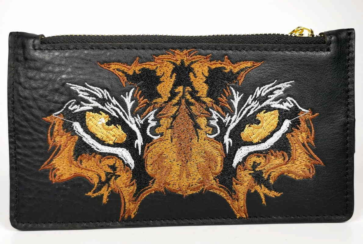 Beauty bag with tiger eyes embroidery design