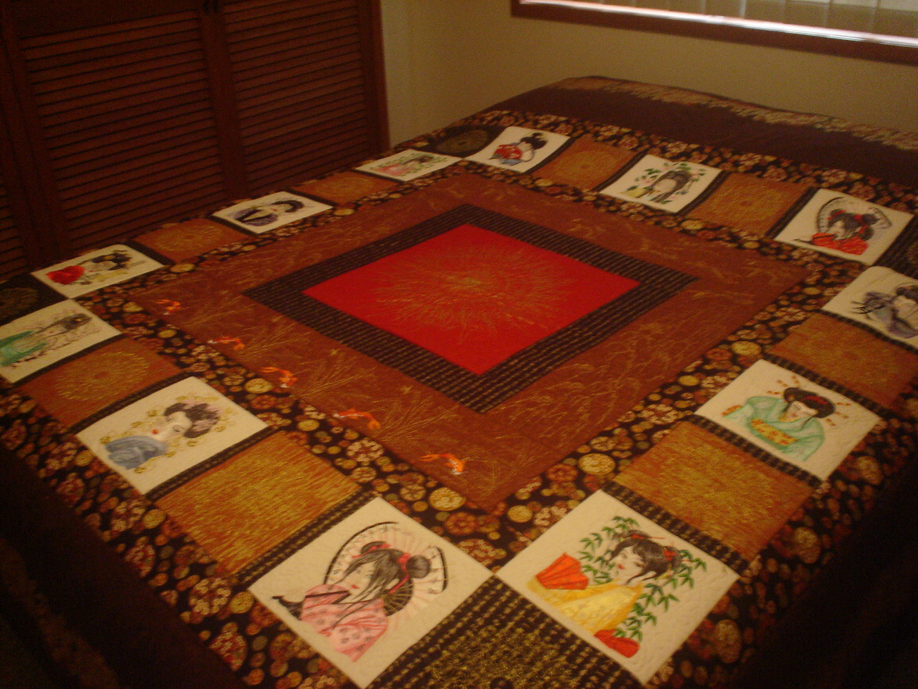 Geisha designs on quilt embroidered