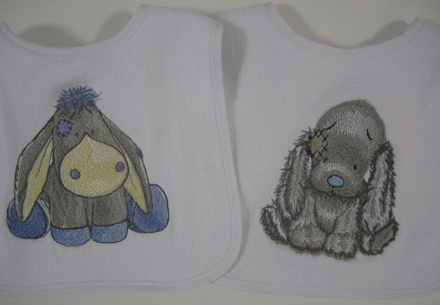 Sugarcube and Bixie embroidery designs on baby bibs