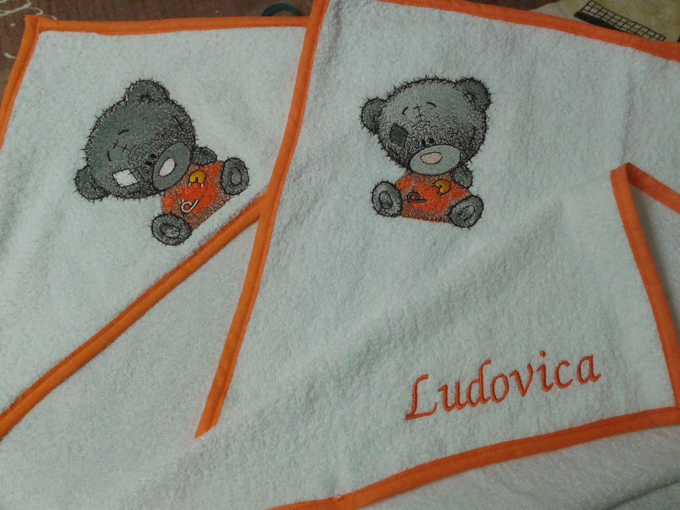 Tatty teddy in diaper embroidered on white towel
