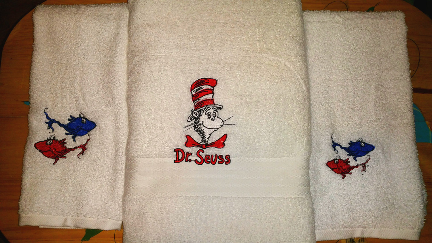 White towels embroidered with lovely Dr. Seuss heroes