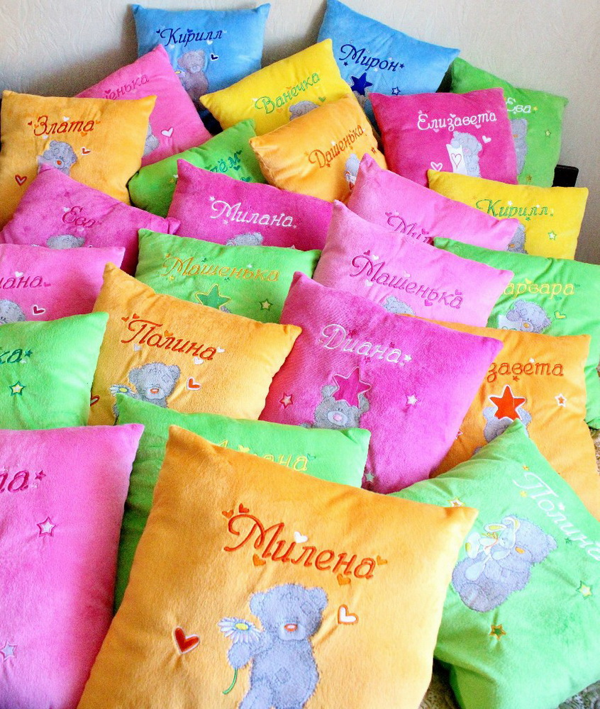 colorful pillowcases with tatty teddy designs embroidered