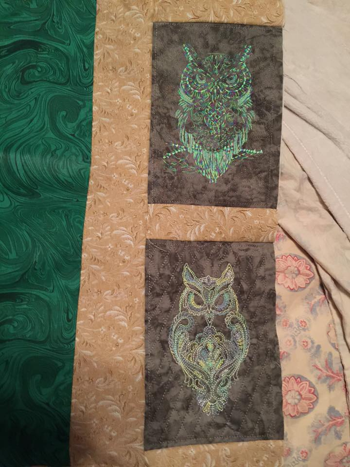 Owls embroidered on quilt