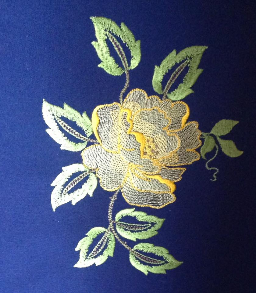 Perfect Rose design on apron embroidered