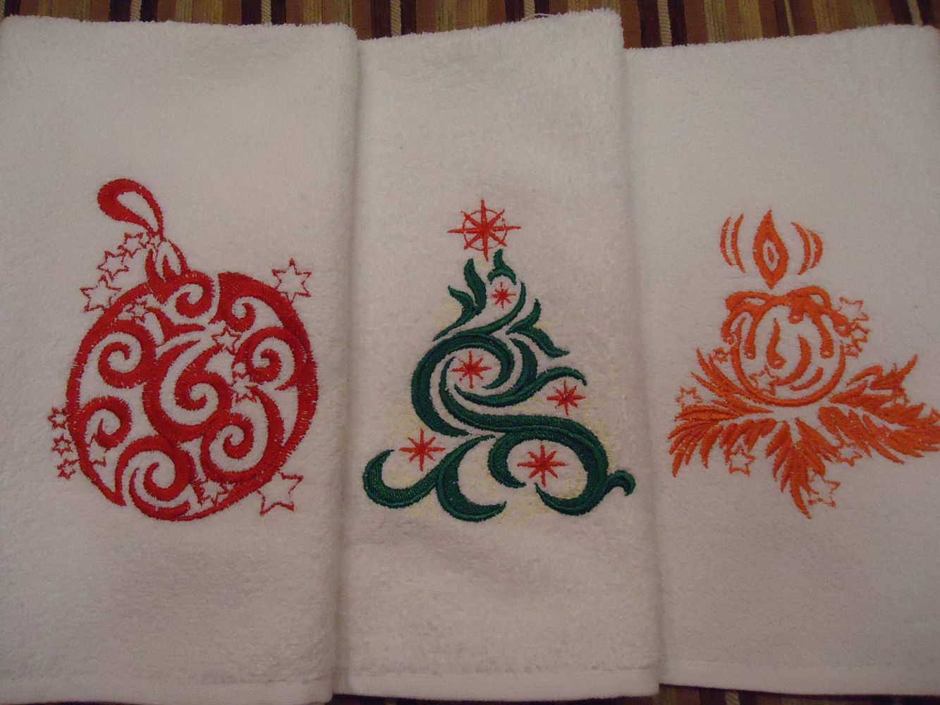 Three towels with Christmas machine embroidery designs