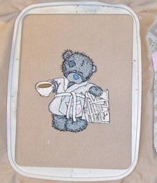 Teddy bear favorite tea and evening newspaper design in embroidery hoop
