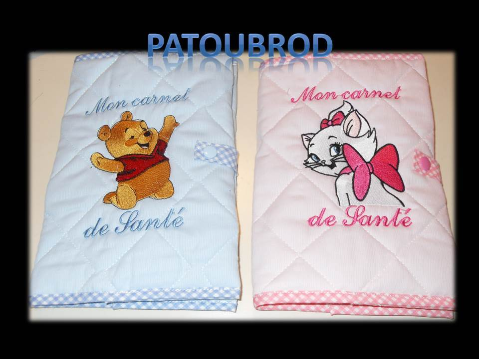 Embroidered cover with Winnie the Pooh and Aristocat