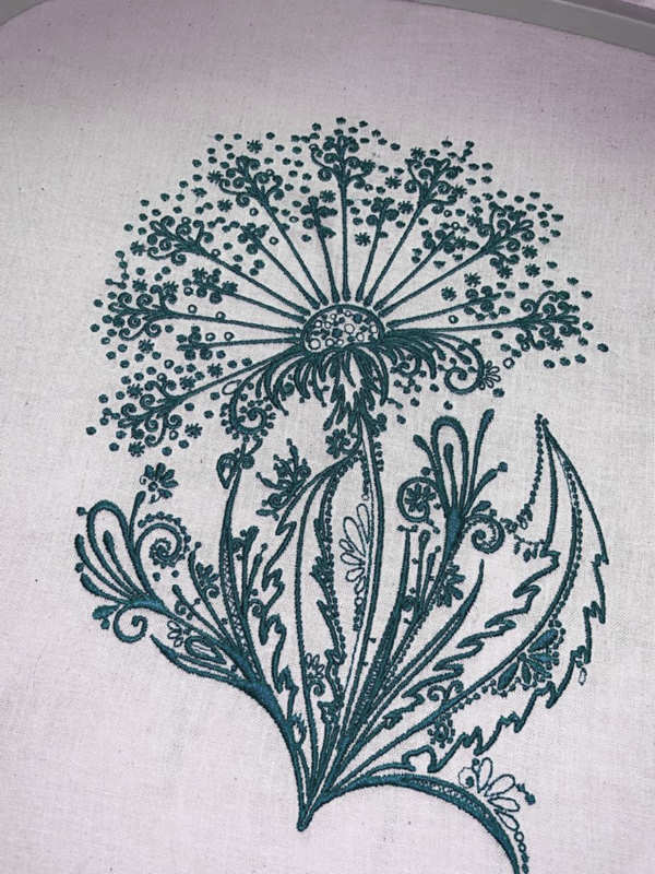 Dandelion blue embroidered design