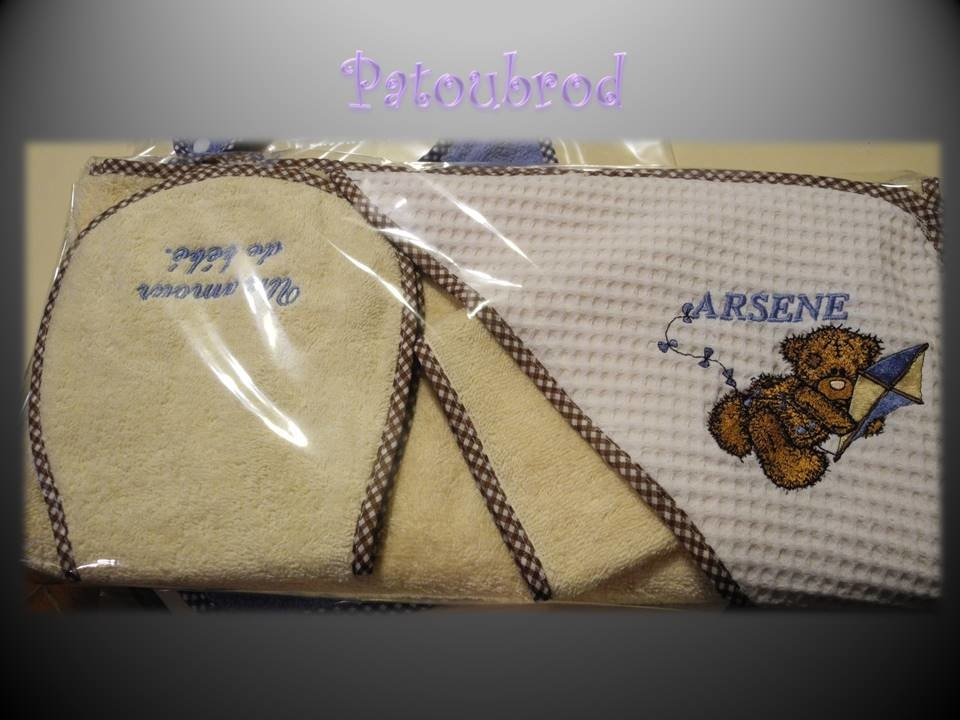 Towel with embroidered tatty teddy bear on it