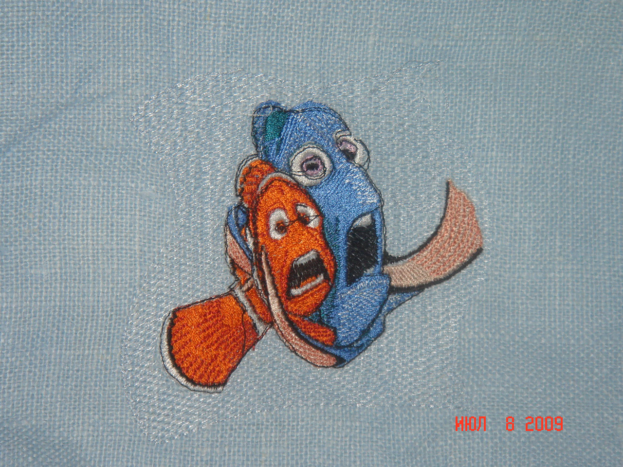 Embroidered Nemo and dory design on bag
