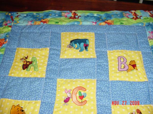 Winnie pooh alphabet designs embroidered on quilt
