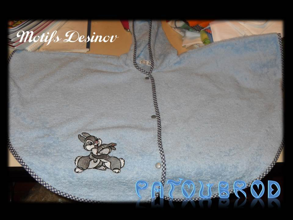 Embroidered poncho towel with bunnies